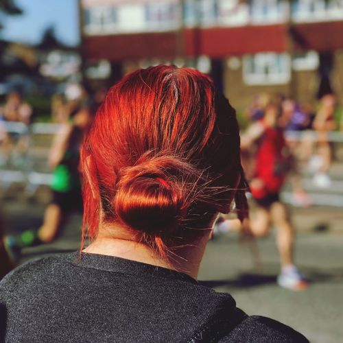 Rear View Of Redhead Woman In City