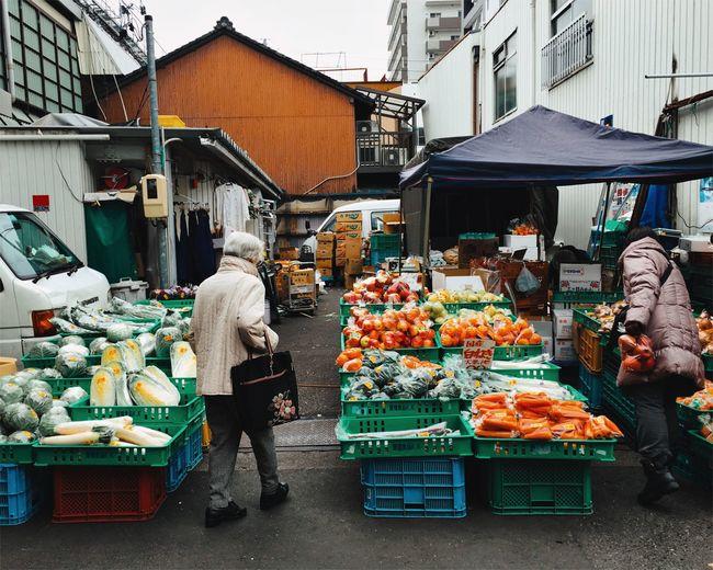 Rear View Of Person Walking In Market