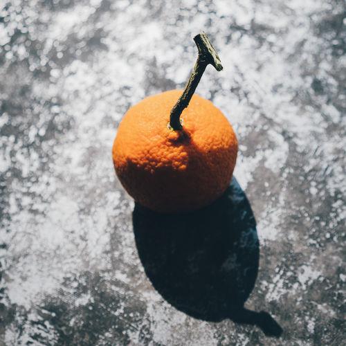 High Angle View Of Fresh Orange Fruit On Concrete