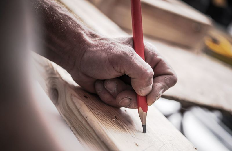 Carpenter Woodwork Job. Contractor Hand with Pencil Closeup Photo. Construction Worker Close-up Constructor Day Hand Human Body Part Human Hand Indoors  Men One Person Real People Wood - Material Woodworking Workshop