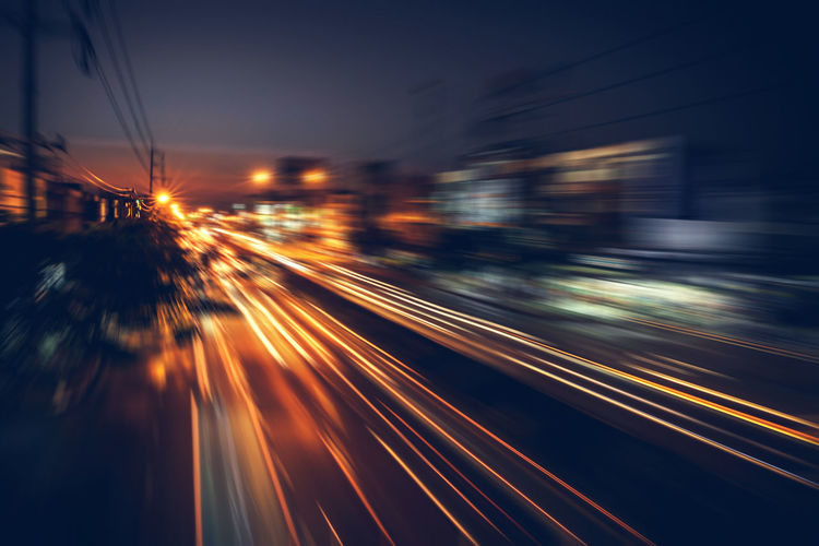 Blurred motion of light trails on street at night