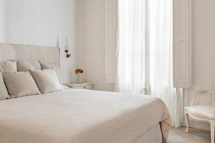 White curtain on bed at home