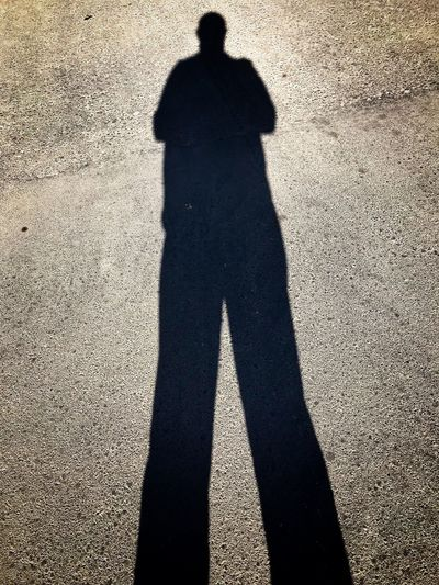 Standing tall! Shadow Sunlight One Person Real People Nature High Angle View Day Lifestyles Standing Focus On Shadow Men City Street Outdoors Unrecognizable Person Asphalt Sunny