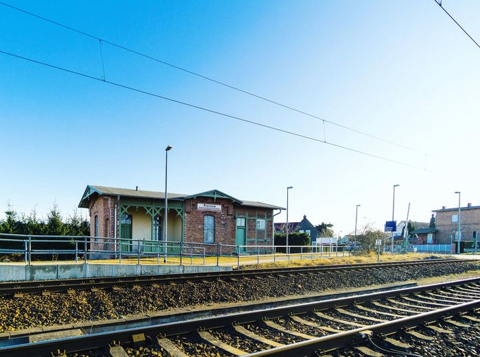 Infrastructure Village Blue Sky Perspective Photography Urban Skyline Streetphotography Brandenburg Germany Train Station Train Railroad Track Rail Transportation Sky Clear Sky Bird Outdoors No People Cable Architecture Day Transportation Building Exterior Built Structure