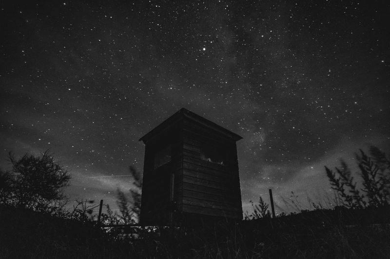 Low angle view of barn against sky at night