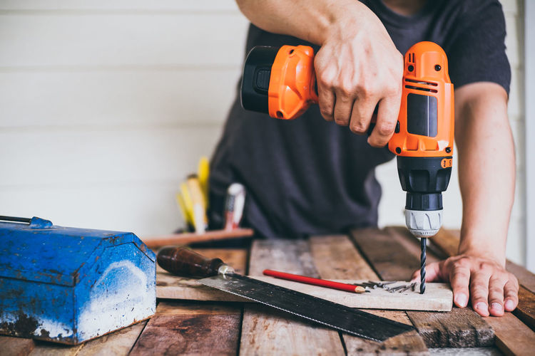 Man Working With Tools At Workbench