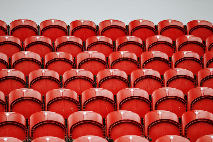 Low angle view of red folded bleachers in auditorium