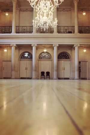 A vertical photo of a Georgian dance floor showing the dance floor and in the distance an ornate wall and two Georgian style chairs Dance Floor Dance Floor Georgian Tea Dance