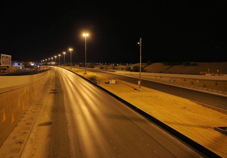 View of highway in city at night