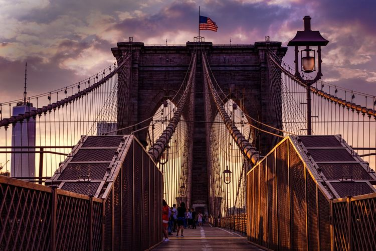 Brooklyn bridge against sky during sunset in city