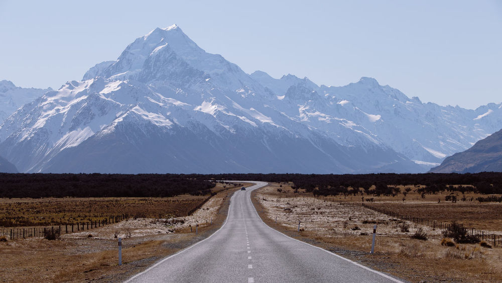Aoraki/Mount Cook, New Zealand Aoraki Day Drive High Huge Landscape Mount Cook Mountain Mountain Range Mt Cook Nature New Zealand No People On The Road Outdoors Panorama Road Scenic Sky Snow South Island Street Tall The Way Forward Winter
