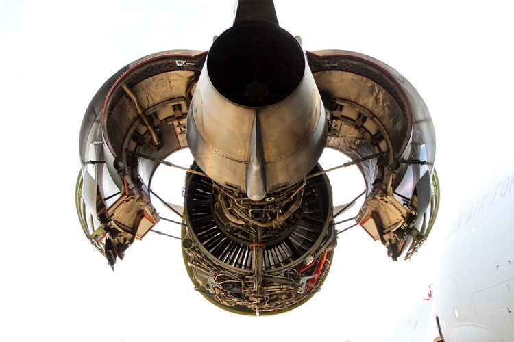 Low angle view of aircraft engine against sky