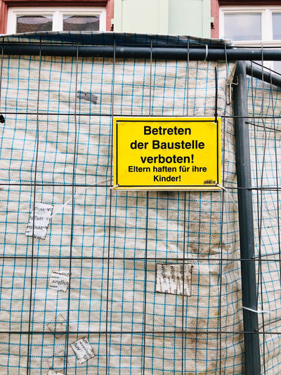 Warning sign on metal structure
