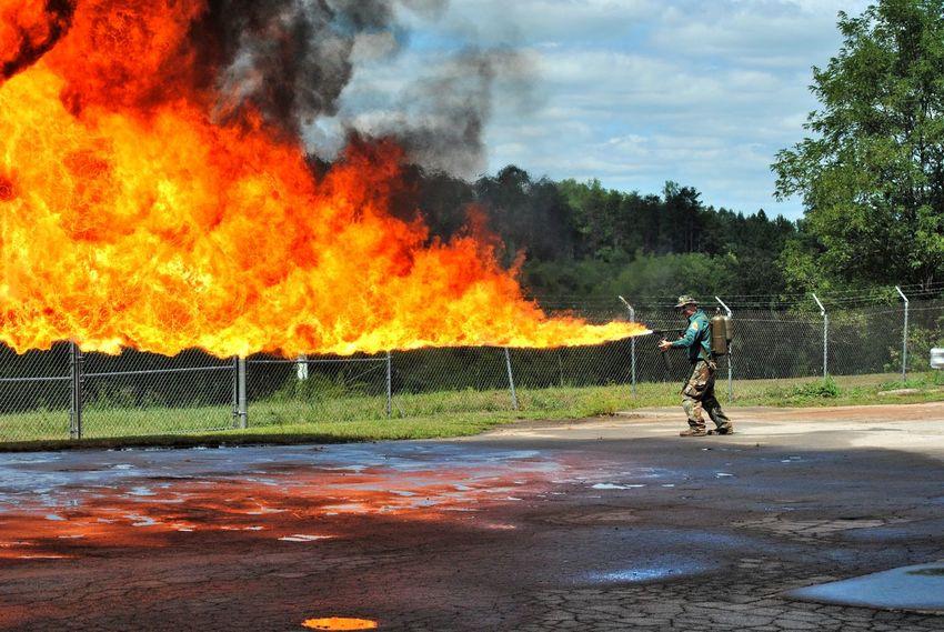 Flamethrower!! Burning Burning Day Eye4photography  EyeEm EyeEm Gallery Fire Fire And Flames Flame Flame Flames Flamethrower Full Length Military Military Weapon Motion Orange Orange Color Outdoor Photography Outdoors Outside Scenics Weapon