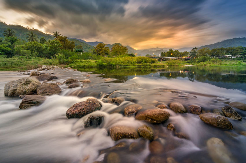 Ban Khiri Wong หมู่บ้านคีรีวง จังหวัดนครศรีธรรมราช ประเทศไทย Ban Khiri Wong Beauty In Nature Cloud - Sky Day Long Exposure Motion Nature No People Outdoors Pebble Pebble Beach River Rock - Object Scenics Sky Sunset Tranquil Scene Tranquility Water Waterfront นครศรีธรรมราช ประเทศไทย หมู่บ้านคีรีวง
