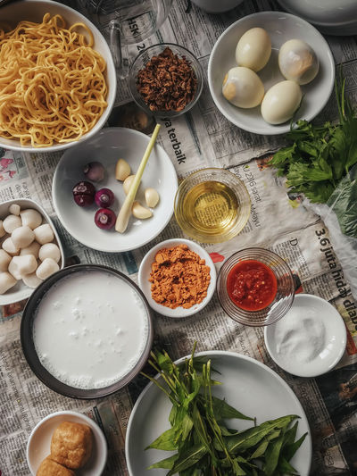 Ingredients Asian Food Bowl Cafe Day Delicious Directly Above Egg Fish Ball Food Food And Drink Freshness Garlic Healthy Eating High Angle View Indoors  Ingredient Kitchen Malay Food Noodle Preparation  Raw Food Restaurant Table Vegetable