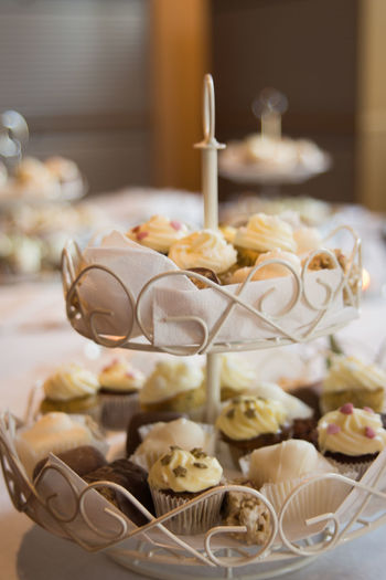 Cup cakes on stand at table
