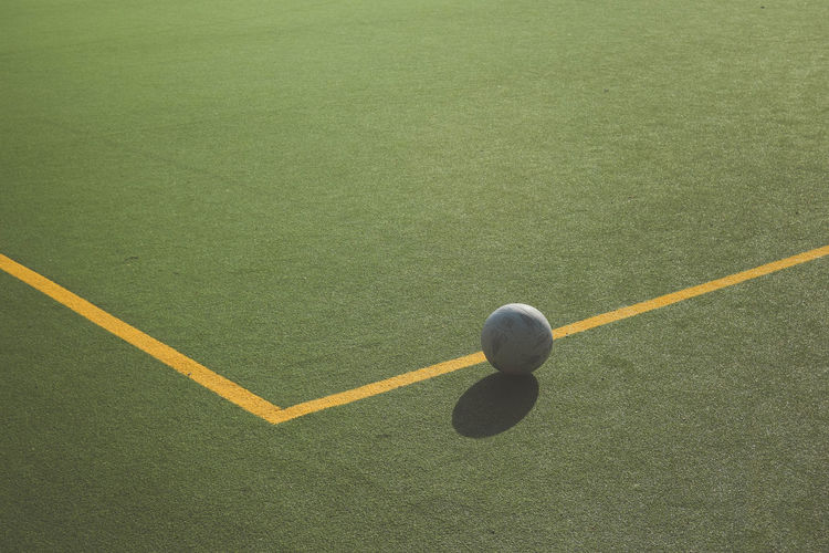 Angles And Lines Artificial Grass Ball Close-up Day Football Leisure Activity No People Outdoors Physical Education Shadow Sport Sports Venue Yellow Lines Astro Turf Line Marking Sports Court Yellow Line