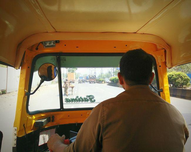 Rear View Of Man Driving Rickshaw