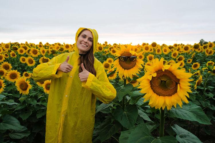 Full length of yellow sunflower on field against sky