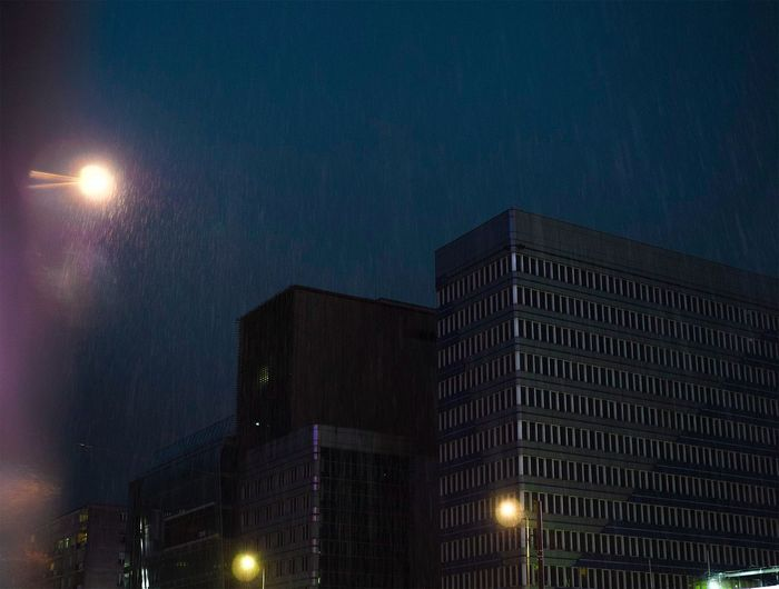Rain Night Illuminated Architecture Building Exterior Built Structure City Adventures In The City Street Light Street Skyscraper Office Building Exterior Lighting Equipment Residential District Outdoors Nature No People Tower Building Low Angle View Dusk Sky Visual Creativity