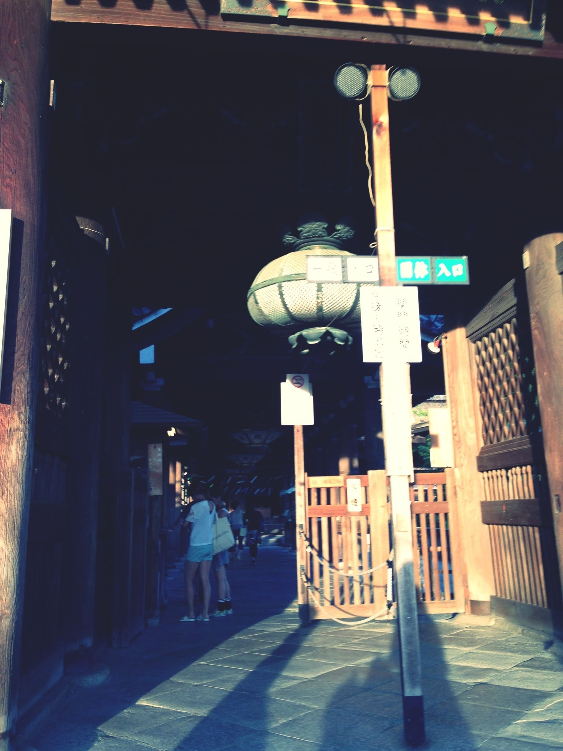 architecture, built structure, building exterior, text, lighting equipment, communication, illuminated, street light, city, western script, low angle view, street, information sign, sign, building, night, guidance, architectural column, outdoors, the way forward
