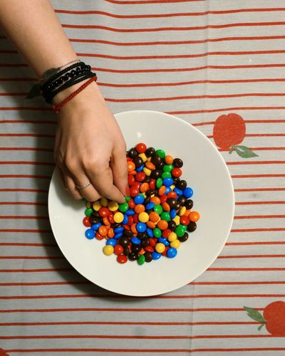 Woman Hand Holding Multi Colored Candies