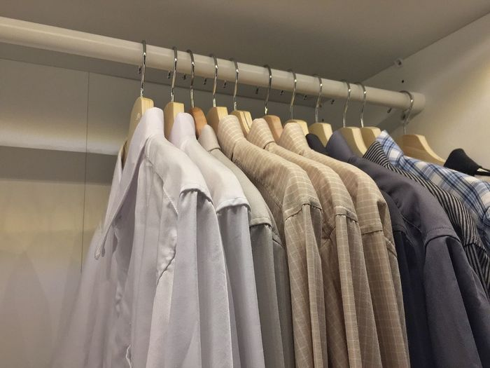 Arrangement Button Down Shirt Choice Clean Closet Clothes Rack Clothing Coathanger Fashion Furniture Hanging In A Row Indoors  Large Group Of Objects No People Order Rack Side By Side Textile Variation White Color