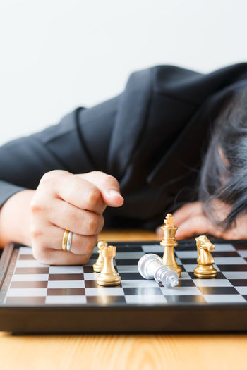 Activity Board Game Boys Chess Chess Board Chess Piece Competition Day Human Body Part Human Hand Indoors  Intelligence King - Chess Piece Knight - Chess Piece Leisure Activity Leisure Games Lifestyles Motion One Person People Playing Queen - Chess Piece Real People Strategy