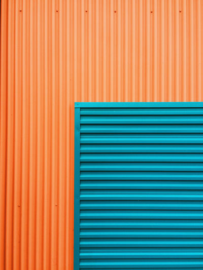 Full frame shot of blue and orange shutter