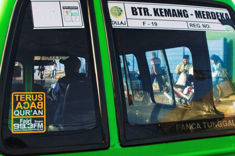 Back of an angkot or city transportation in Bogor, Indonesia. December 2017 Street Scene Driver Drive Green City Transportation Local Transport Car Transportation UNPOSED Candid Driving Traffic Text Business Finance And Industry Day No People Outdoors Close-up EyeEm Ready