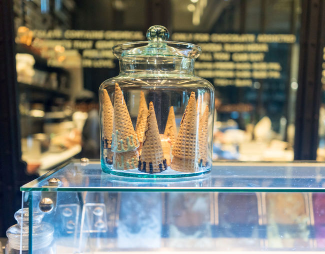 Close-up of ice cream cones on display cabinet