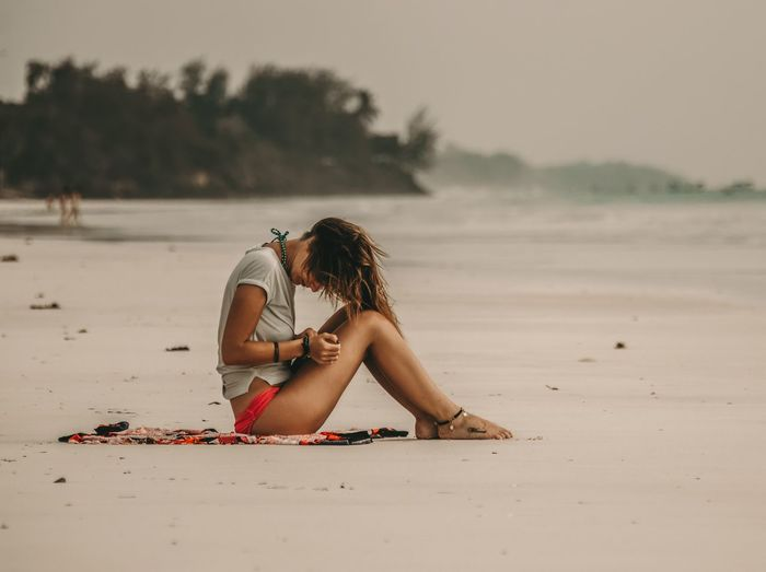 Oceanfront | Moody Diani Beach Kenya Beach Sand One Person Young Adult Real People Young Women Sea Long Hair Leisure Activity Nature Full Length Sitting Beautiful Woman Outdoors Water Lifestyles Sky Beauty In Nature Vacations Day The Traveler - 2018 EyeEm Awards The Portraitist - 2018 EyeEm Awards