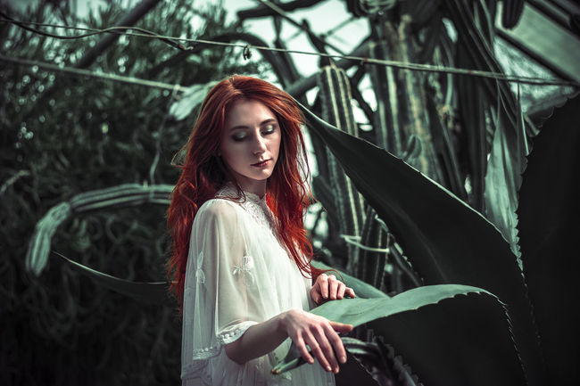 Alice in Wonderland NIKON D5300 50mm EyeEm Best Shots HelloEyeEm EyeEm Photography Photoart Photographer Redhead Beauty Model Garden Garden Photography Fantasy Alice In Wonderland Nostalgia Sadness Colorful Imagination Portrait Feelings Dreaming Green Red White