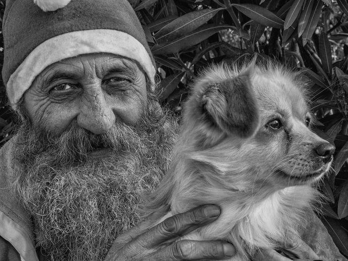 Close-up portrait of senior man with dog