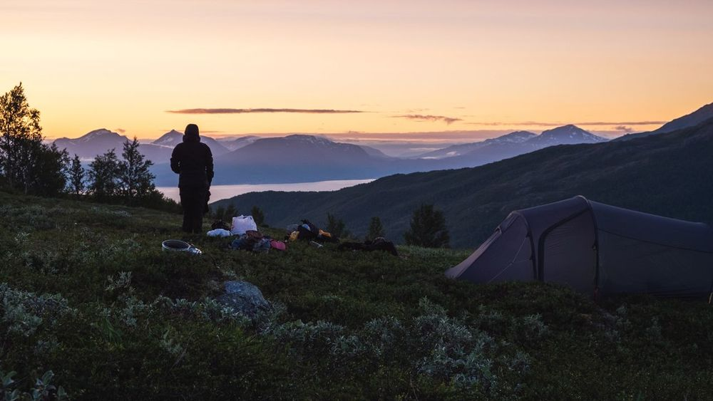 Camping in Norway Tent Mountains Mountaineering Mountaineering Landscape Camping Campinglife Sunset Silhouette One Person One Man Only People Landscape Mountain Scenics Hiking Sunlight Adventure Lifestyles Outdoors EyeEmNewHere
