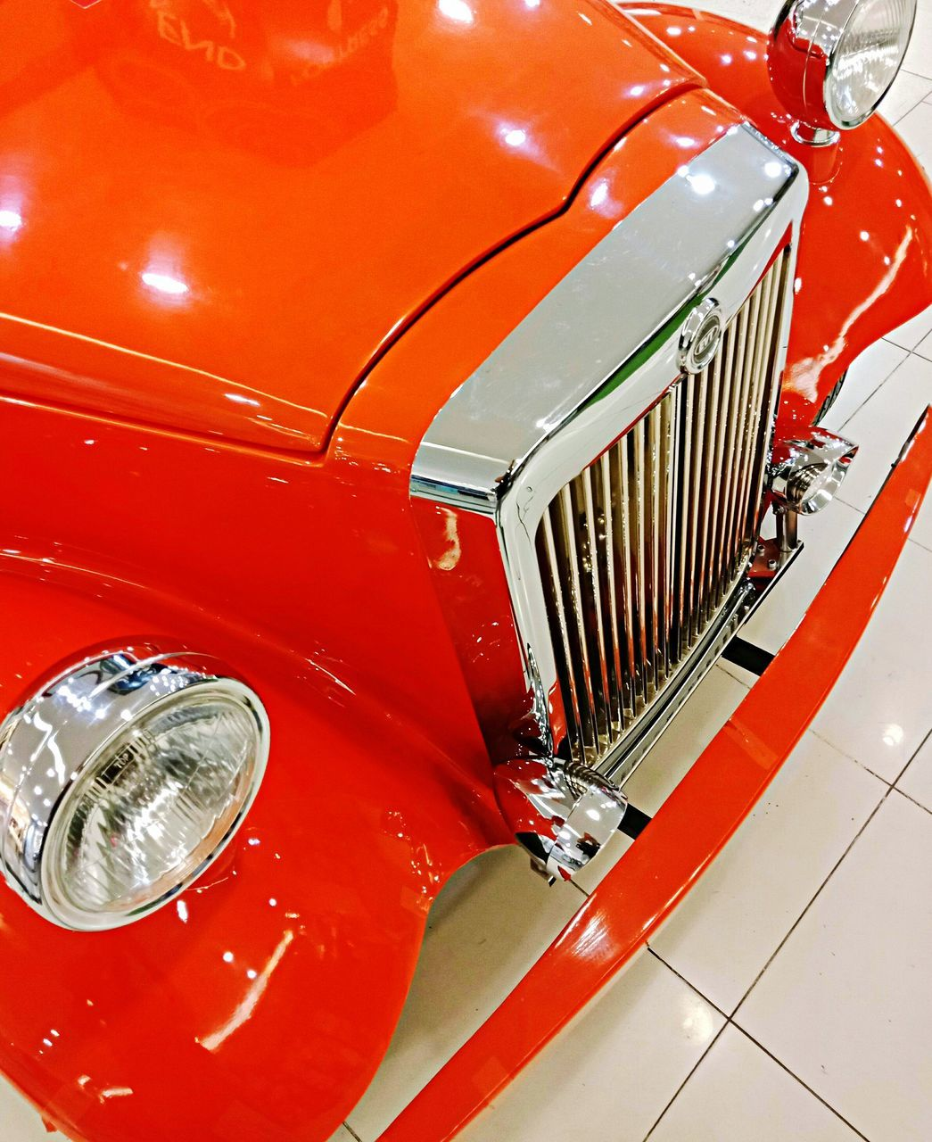 red, headlight, land vehicle, car, motor vehicle, vintage car, transportation, mode of transportation, metal, no people, retro styled, close-up, lighting equipment, shiny, machinery, indoors, high angle view, modern, wealth, chrome, electric lamp, luxury