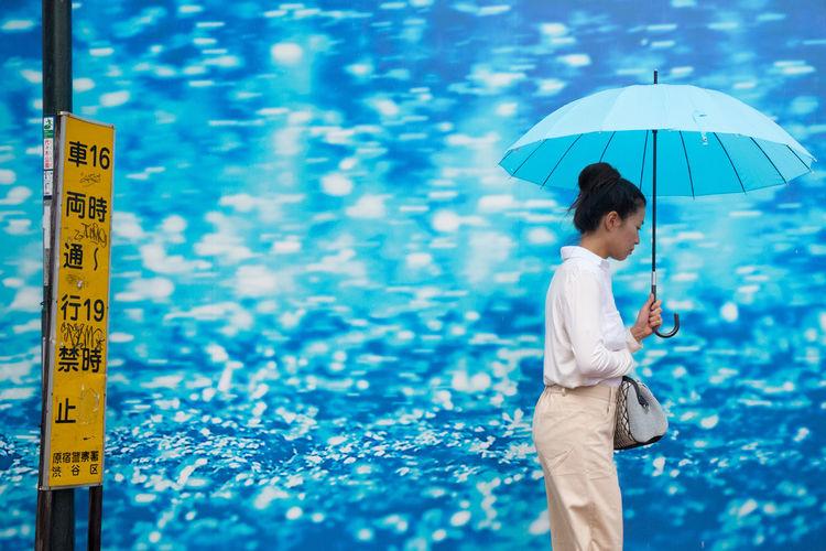 Full length of man against blue water