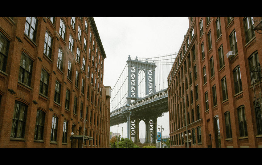 USA Photos Last Summer Let's Go Explore NYC NYC Photography Brooklyn Manhatten Bridge Bridge Once Upon A Time In America Cinema In Your Life Cinematic Rainy Days Rainy Low Angle View Architecture No People Bridge - Man Made Structure City Urban Geometry Taking Photos Travel Destinations Building Built Structure The Way Forward Photography