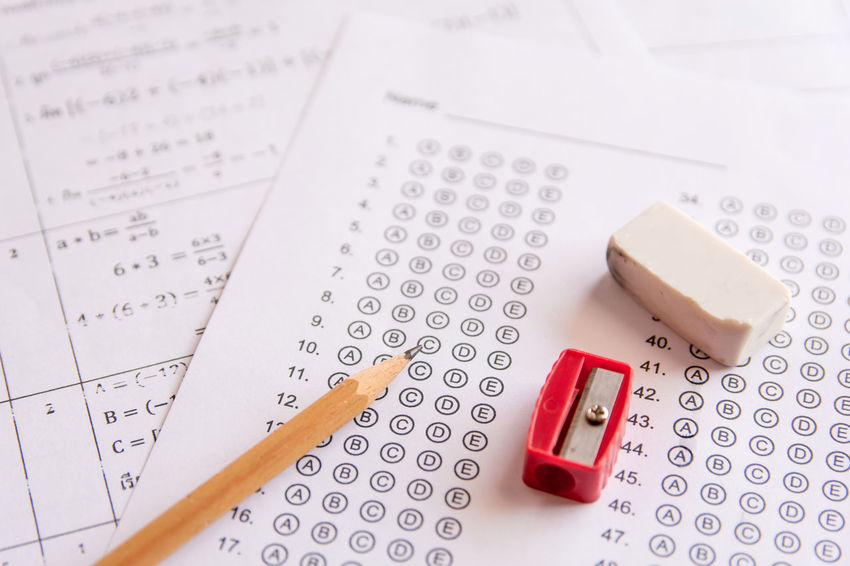 Pencil, Sharpener and eraser on answer sheets or Standardized test form with answers bubbled. multiple choice answer sheet Choice Quiz Answer Bubble Class Education Exam Indoors  Indulgence Knowledge Number Packet Pencil Pill Question Questions Red Score Shape Shcool Table Test Text Western Script White Color