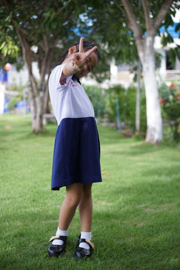 Khwan Khaw after school. Student Thai Thailand After School Child Day Females Field Focus On Foreground Full Length Girl Girls Grass Hairstyle Innocence Kid Leisure Activity Lifestyles Nature One Person Outdoors Park Plant Real People Standing Student Uniform Unifrom Women Young Adult The Portraitist - 2018 EyeEm Awards The Fashion Photographer - 2018 EyeEm Awards The Still Life Photographer - 2018 EyeEm Awards