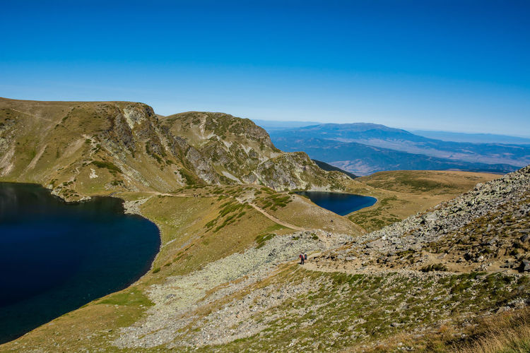 Seven Rila Lakes, Bulgaria The Eye Окото (Okoto) 2,440 m (8,010 ft) 6.8 ha (17 acres) 37.5 m (123 ft) Named after its oval shape. Deepest cirque lake in Bulgaria The Kidney Бъбрека (Babreka) 2,282 m (7,487 ft) 8.5 ha (21 acres) 28.0 m (91.9 ft) Steepest shores of all Mountain Scenics - Nature Sky Beauty In Nature Tranquil Scene Blue Landscape Environment Tranquility Nature Non-urban Scene No People Mountain Range Day Water Land Idyllic Remote Clear Sky Outdoors Lake Nature Nature_collection Nature Photography Beauty In Nature