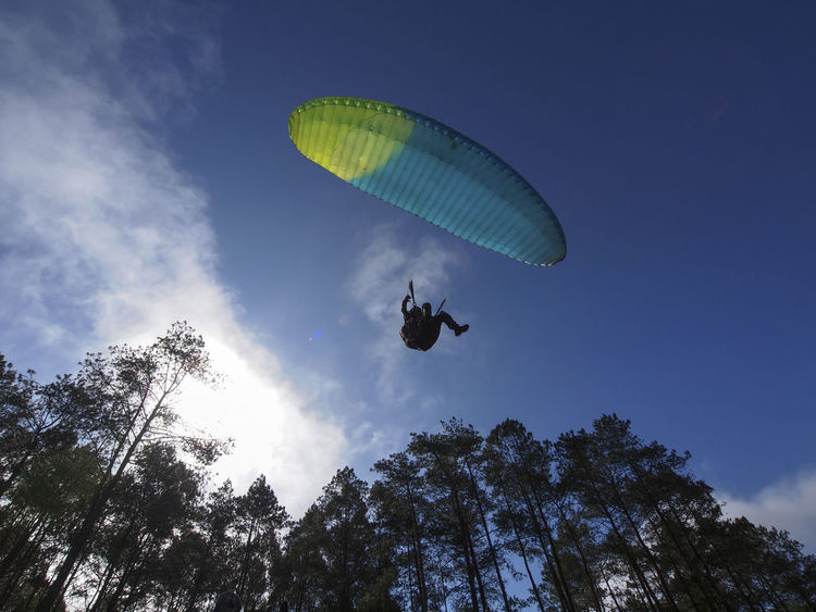 Located at Lawang Peak, West Sumatera Indonesia. A place for Paragliding Sport. From this place we can see a beautiful Lake Maninjau which becomes the landing zone. Backlight Silhouette Adventure Day Extreme Sports Flying Leisure Activity Low Angle View Mid-air Nature One Person Outdoors Parachute Paragliding Sky Sport Tourism Tree Westsumatera