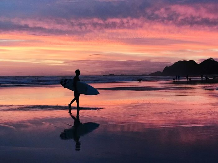 Session over Surfers Paradise Surfer Water Sunset Sky Beach Sea Reflection Beauty In Nature One Person Tranquil Scene Orange Color Silhouette