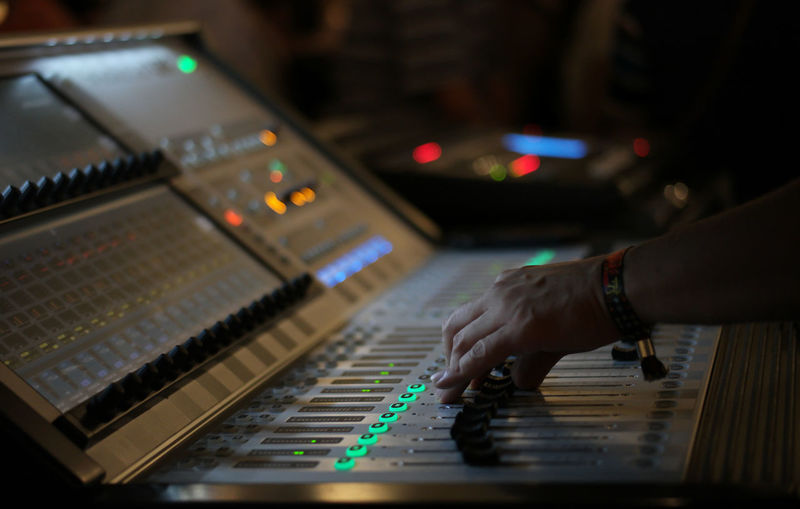 Cropped Hands Mixing Music With Sound Recording Equipment In Studio
