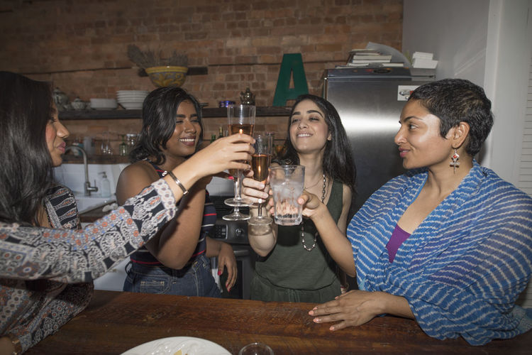 Group of people in drinking glass