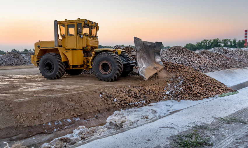 View of bulldozer at sunset