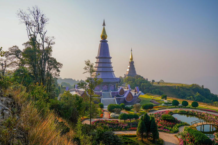 Tree Sky Plant Built Structure Architecture Building Exterior Religion Belief Place Of Worship Nature Building Spirituality No People Travel Destinations Tower Clear Sky History Day Outdoors Spire  Doi Inthanon Chiang Mai Chiang Mai | Thailand