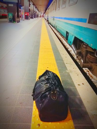 BackHome TheTraveler Transportation City Outdoors People Day Adult Transportation Tren Train Train Station Bag Black Bag Backhome Rome Romatermini