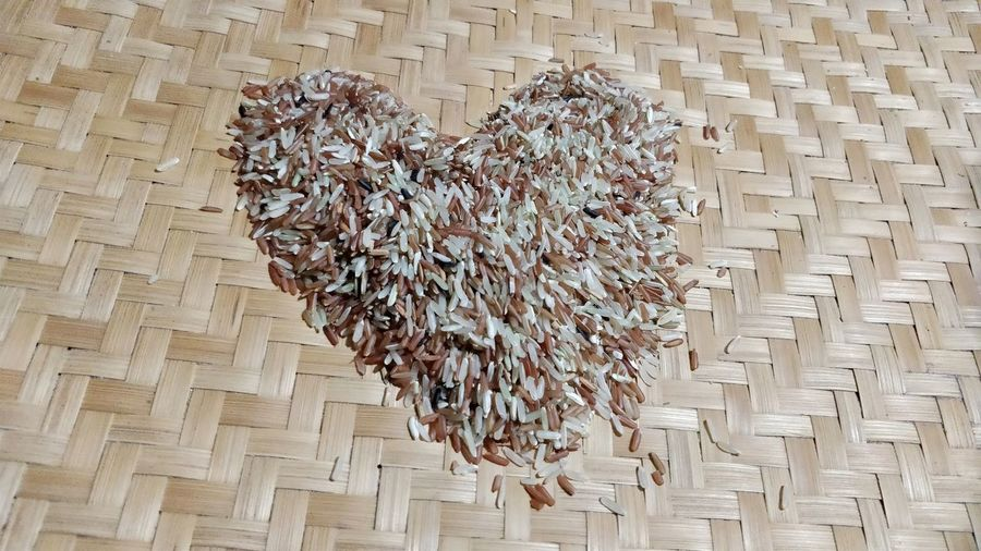 High Angle View Of Heart Shape Made With Rice On Wicker